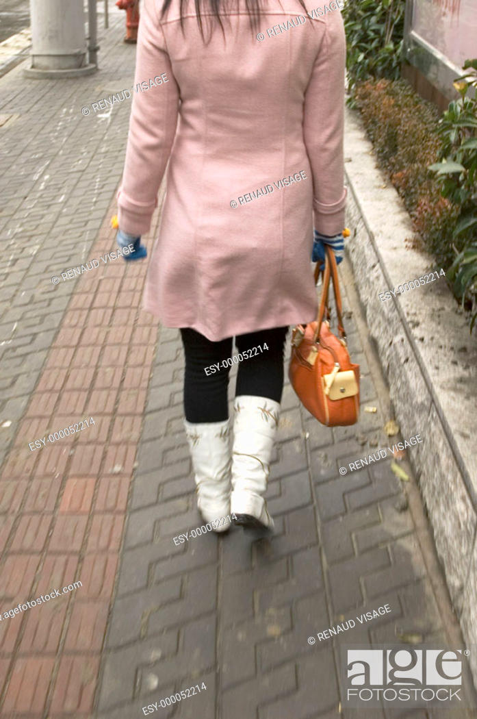 Stock Photo: Young woman in trendy white boots. Shanghai. China.