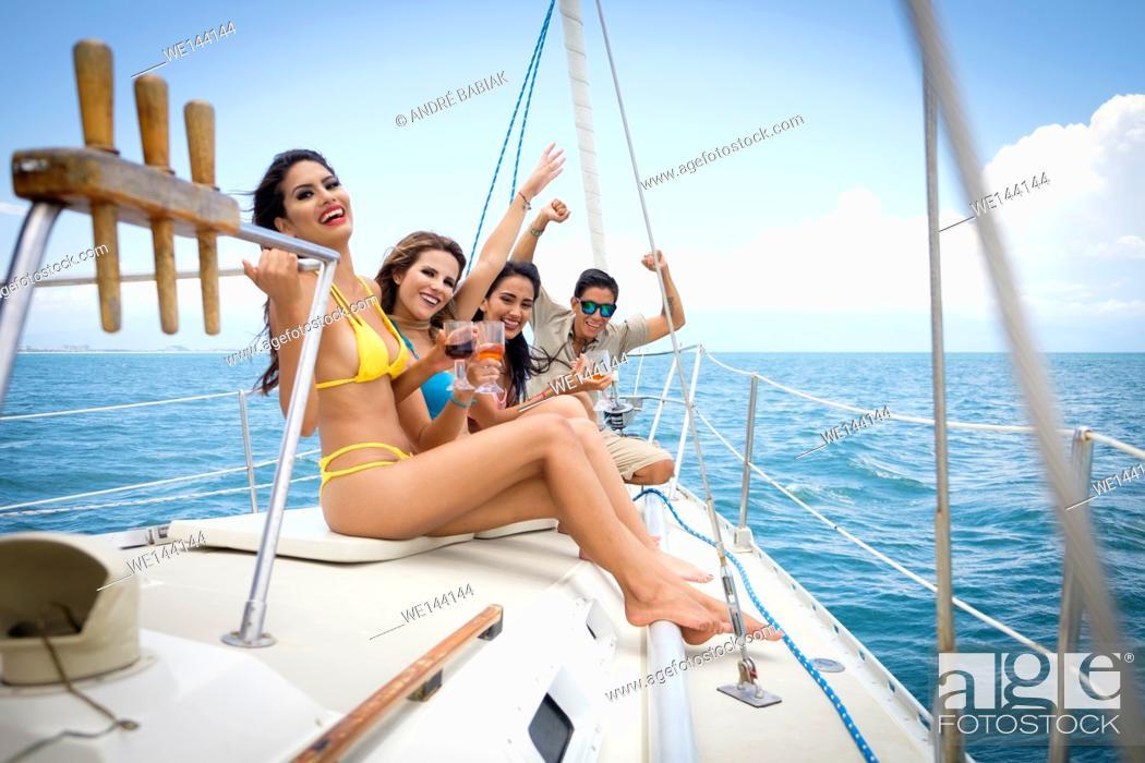Stock Photo: Group of young people enjoying a sailboat tour, Riviera Nayarit, Mexico.