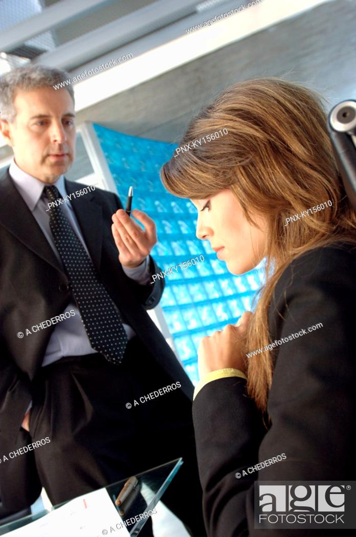 Stock Photo: Businessman conversing with employee in office.