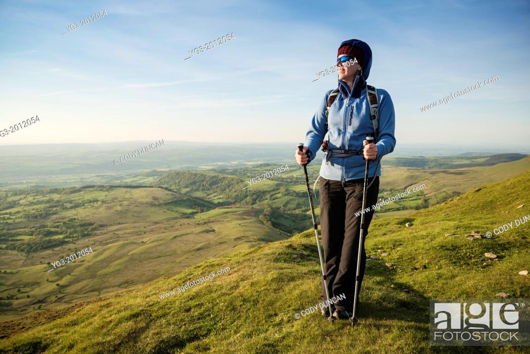 Stock Photo: Female hiker on summit of Twmpa, Black Mountains, Brecon Beacons national park, Wales.