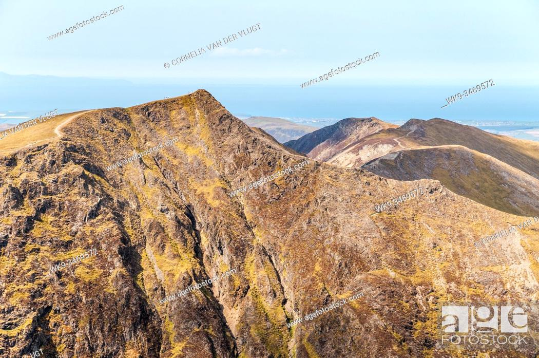 Stock Photo: View of Hopgill Head with Hobcarton Crag and the ridge route towards Whiteside in the English Lake District on a clear sunny day in spring.