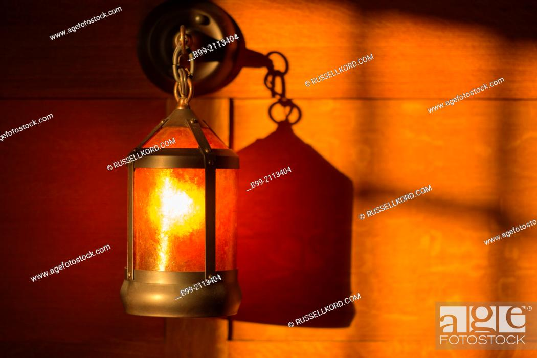 Stock Photo: Shadows Of Window And Sconce Lantern On Wood Paneled Wall Of American Arts And Crafts Style Home.