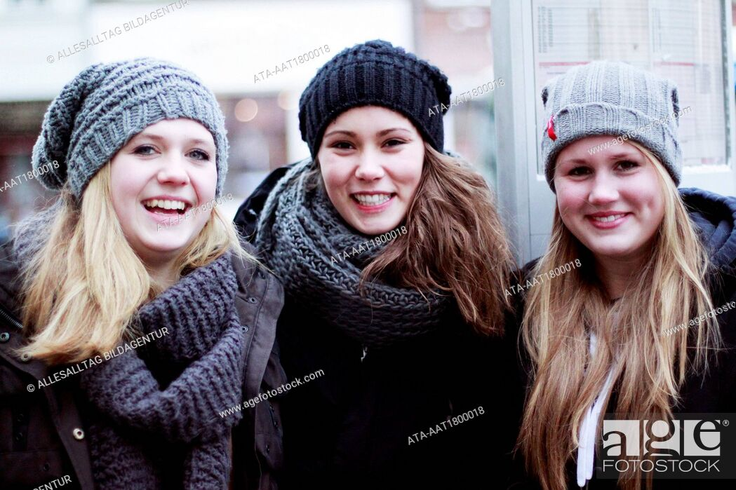 Stock Photo: Three young girls in the winter.