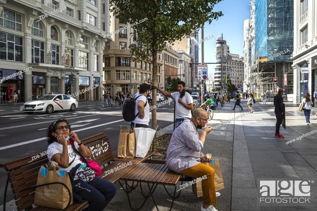 Stock Photo: people with face mask in gran via street. madrid. spain.