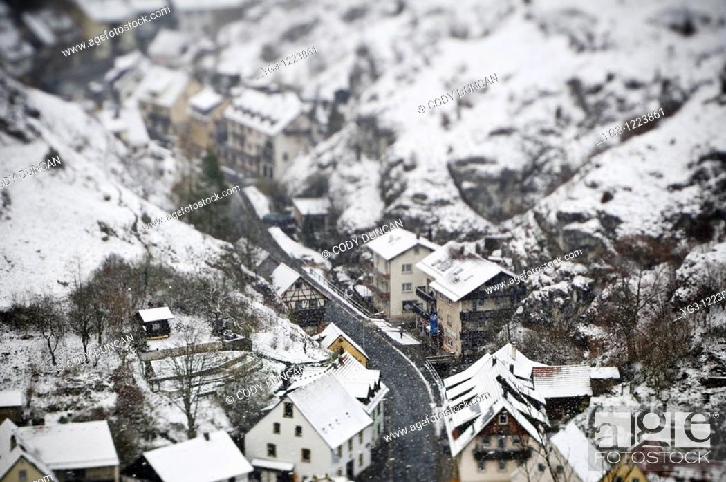 Stock Photo: snow covered houses during winter storm, Pottenstein, Franconia, Bavaria, Germany.