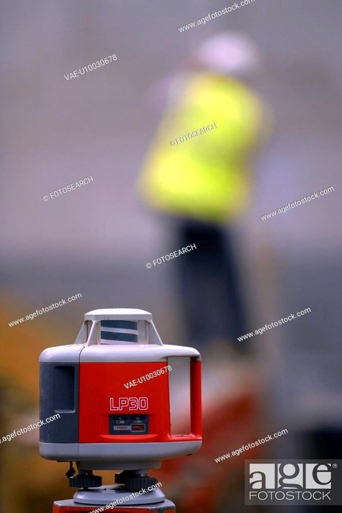 Stock Photo: Close up of LP30 rotating laser level on tripod.