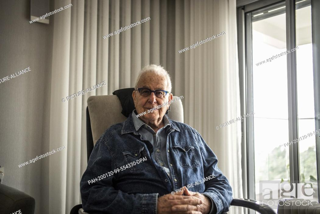 """Stock Photo: 20 January 2020, Israel, Haifa: Naftali Fürst, an 87-year-old Holocaust survivor, is sitting in an armchair in his home. Under the title """"""""Survivors."""