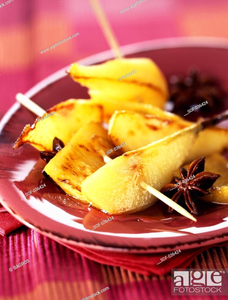 Stock Photo: pineapple and pear brochettes with star anise.