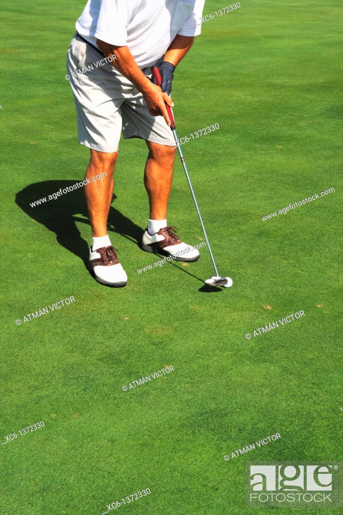 Stock Photo: Senior man playing golf, South Tenerife, Canary Islands, Spain.