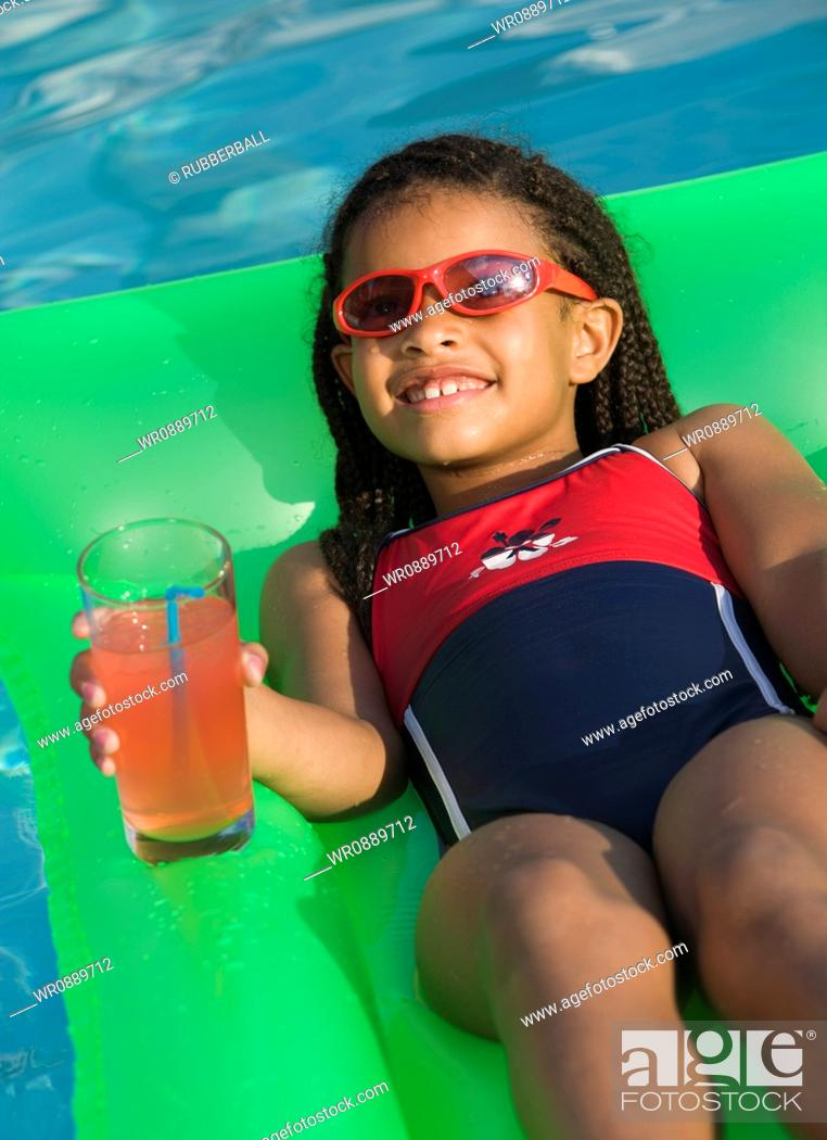Stock Photo: Close-up of a girl lying on a float.