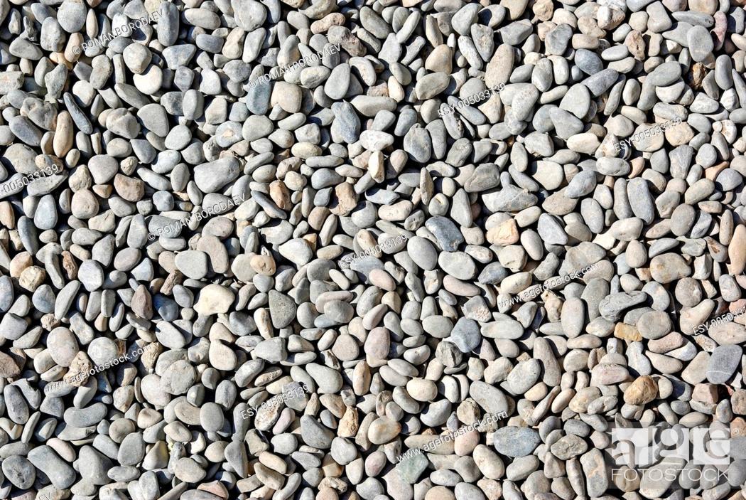 Imagen: Gray small pebble as background or backdrop. Coastline of Spain.