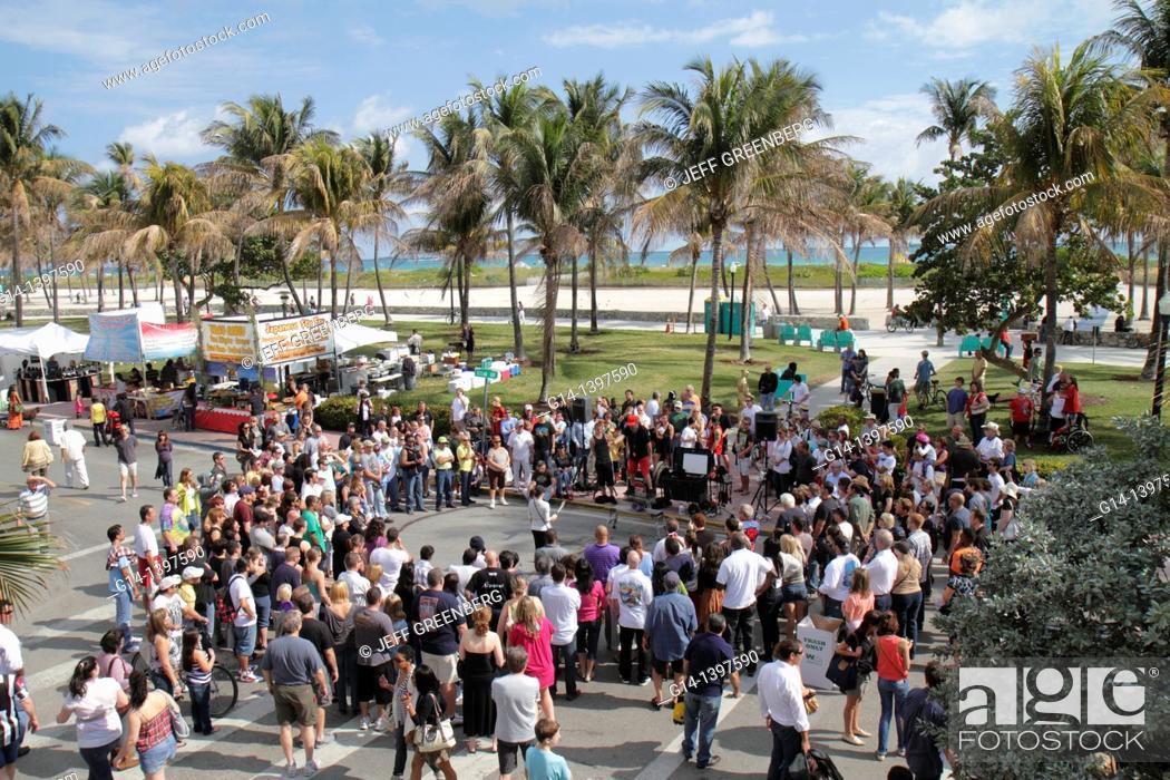 Stock Photo: Florida, Miami Beach, 'Ocean Drive', Art Deco Weekend, festival, fair, street performer, audience, Lummus Park,.