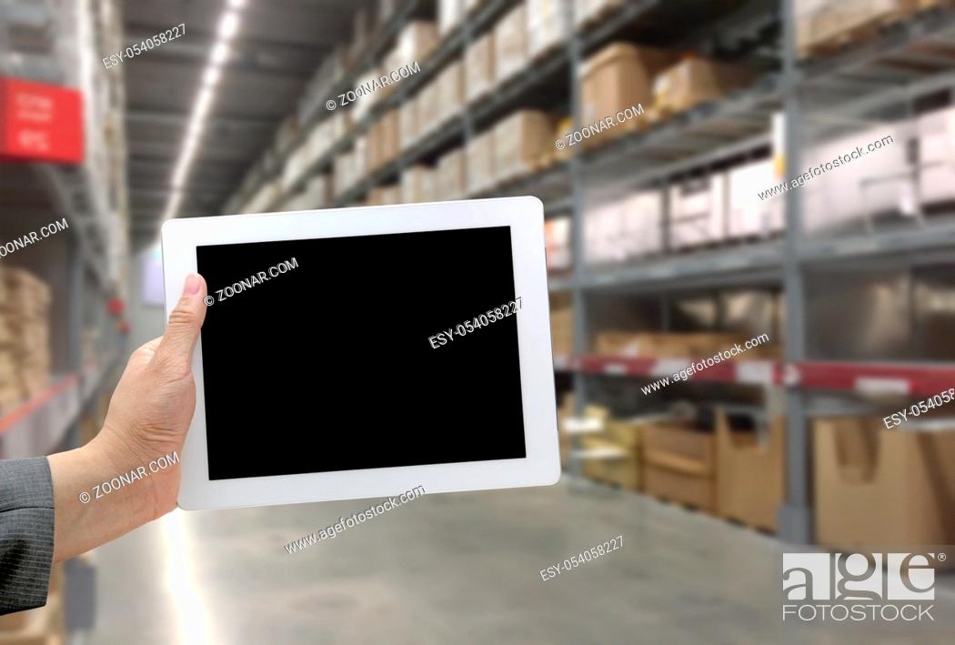 Stock Photo: Abstrast Blurred background : Warehouse cargo with digital tablet.