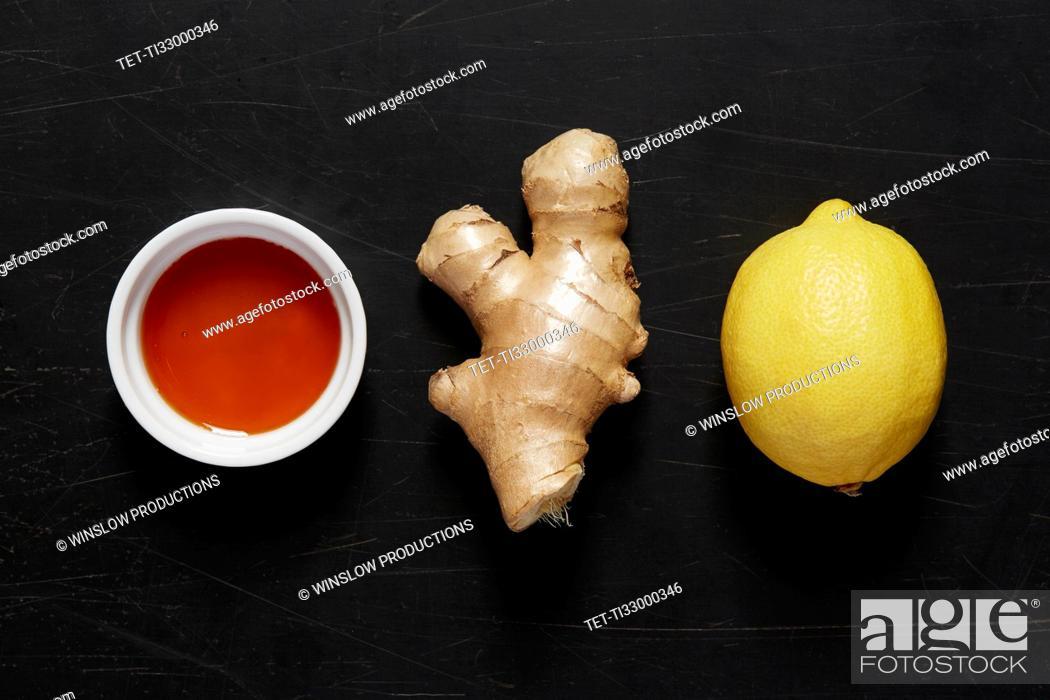 Stock Photo: Bowl with honey, ginger and lemon.