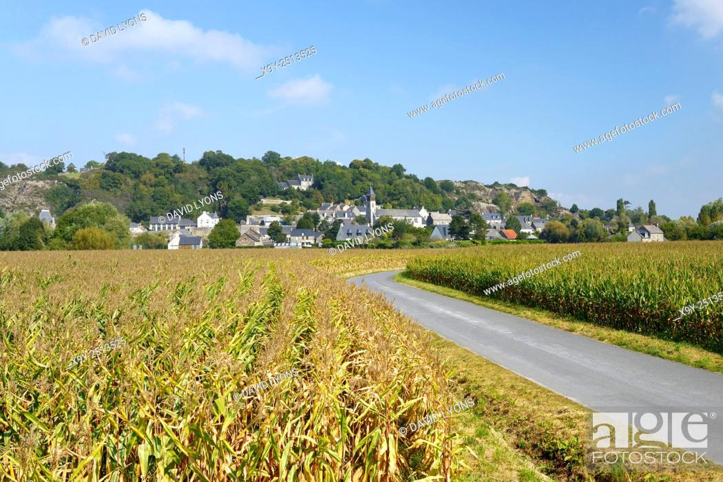 Stock Photo: East over cornfields to granite hill and village of Mont Dol. Near Saint Malo and town of Dol-de-Bretagne, Brittany, France.