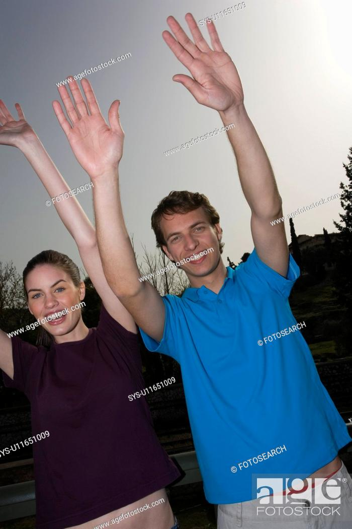 Stock Photo: Couple with hands up.