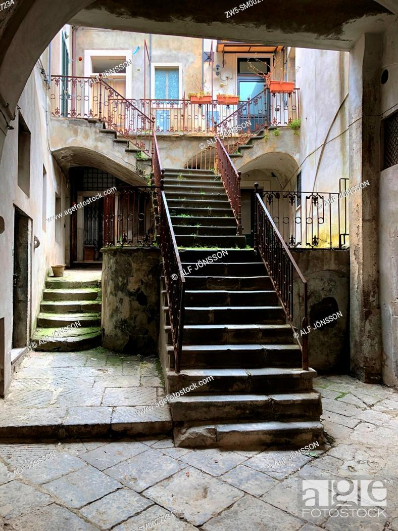 Stock Photo: Stairs and doors in a backyard in Venosa, Potenza district, Basilicata, Italy.