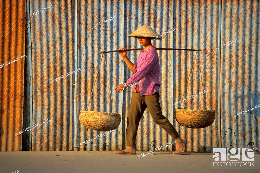 Stock Photo: Vietnam, Hanoi wife and yoke.
