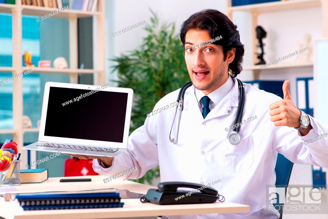 Stock Photo: Young handsome doctor in telemedicine concept.