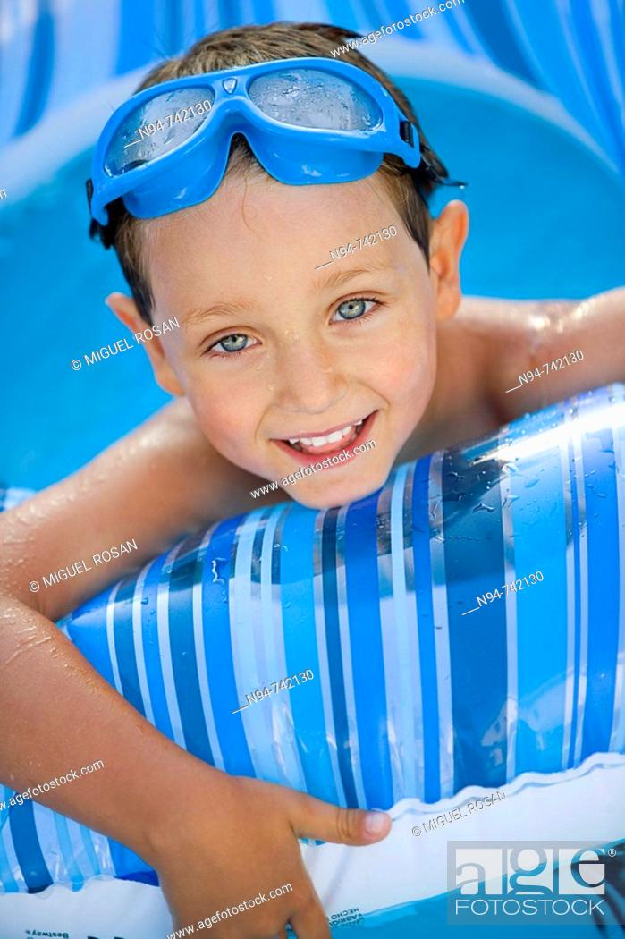 Stock Photo: Young boy in swimming pool.