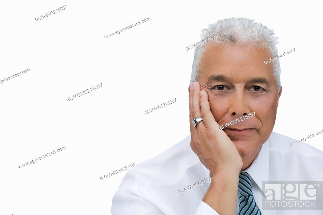 Stock Photo: Portrait of a senior man thinking with his hand on his chin.