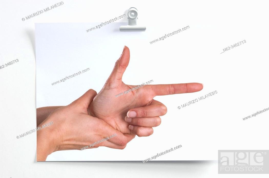 Stock Photo: Blank sheet hanging on the wall with image of hands simulating a gun that shoots.