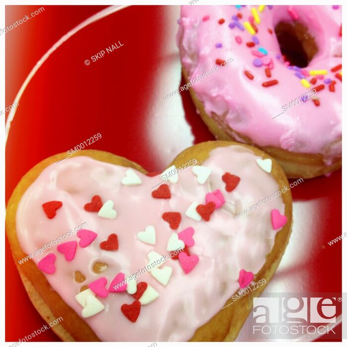 Stock Photo: Fresh doughnuts for Valentines Day.