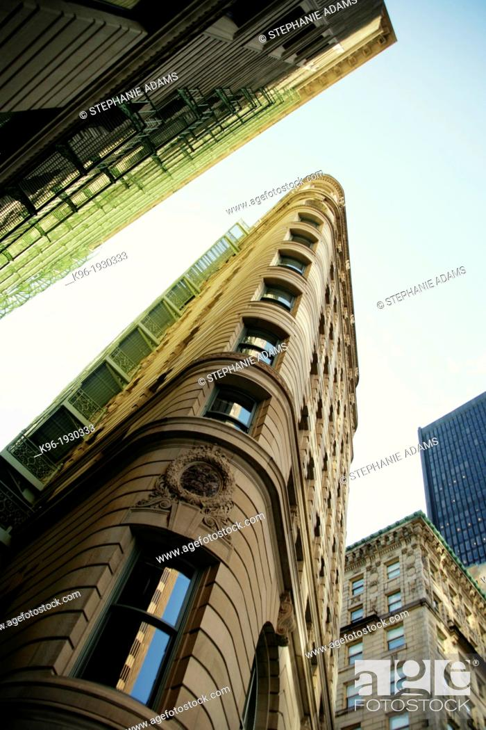 Stock Photo: interesting curved old building shot with a wide angle lens to push it up into the sky.