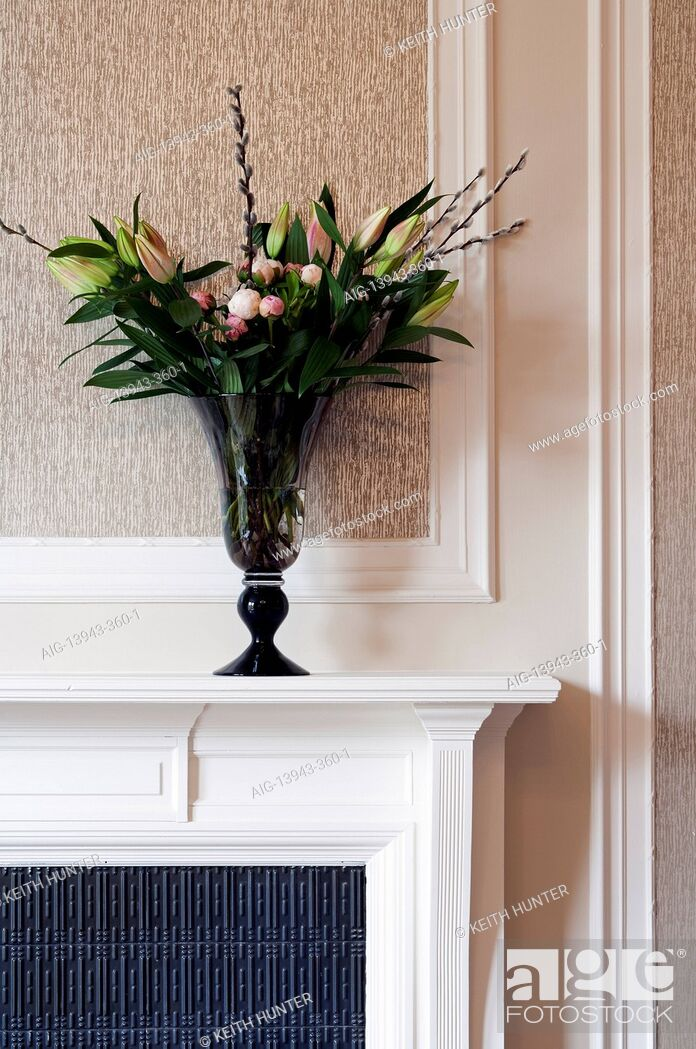 Stock Photo: Flower arrangement on mantelpiece, Devonshire Terrace, Glasgow, Scotland, UK.