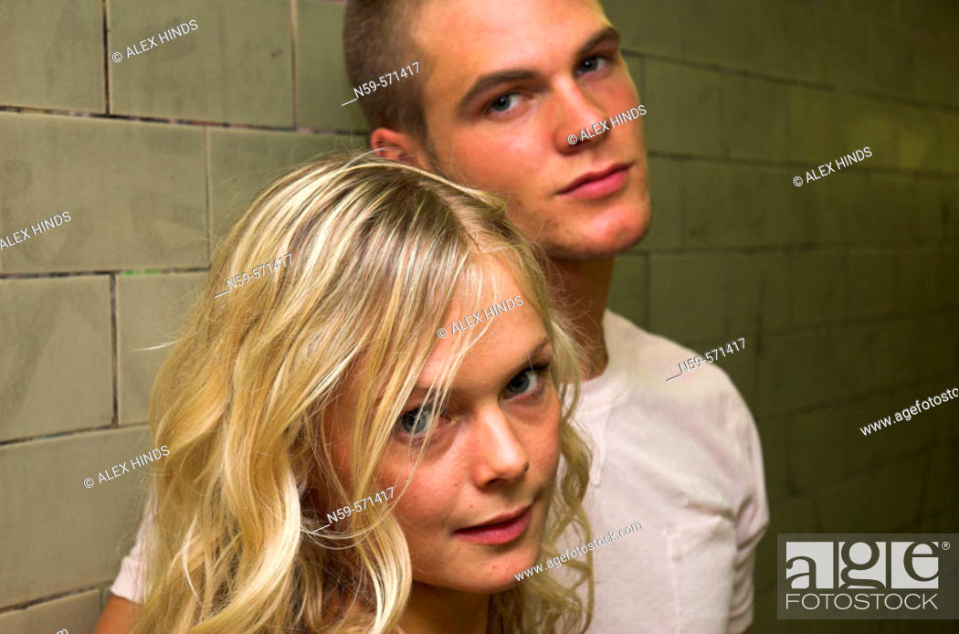 Stock Photo: Attractive young couple looking at the camera. Focus on the girl.