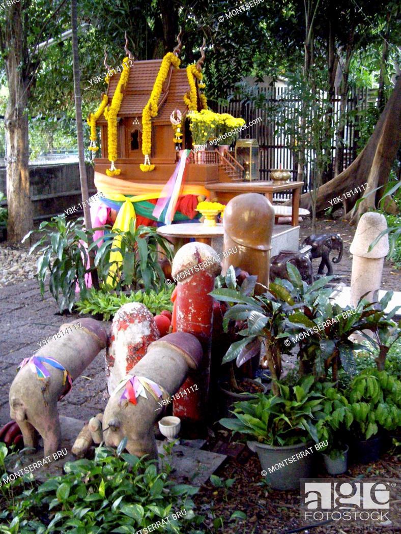 Stock Photo: Phallic shape offering at fertility shrine in Bangkok, Thailand.