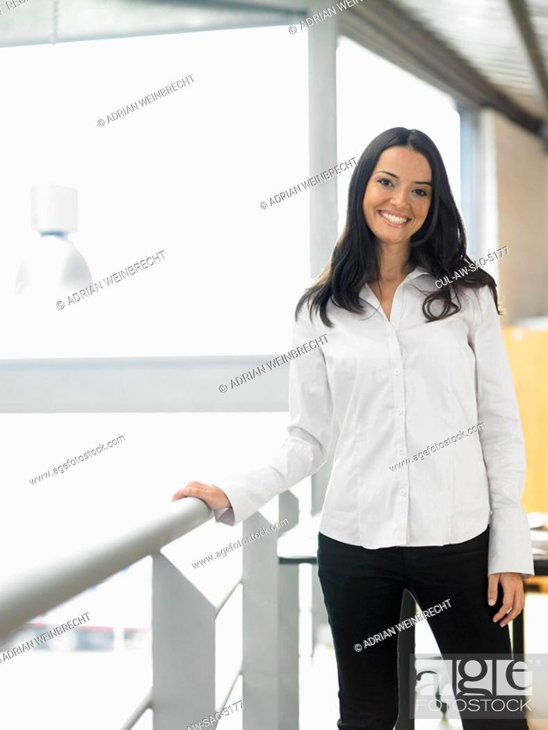 Stock Photo: Businesswoman working in an office.