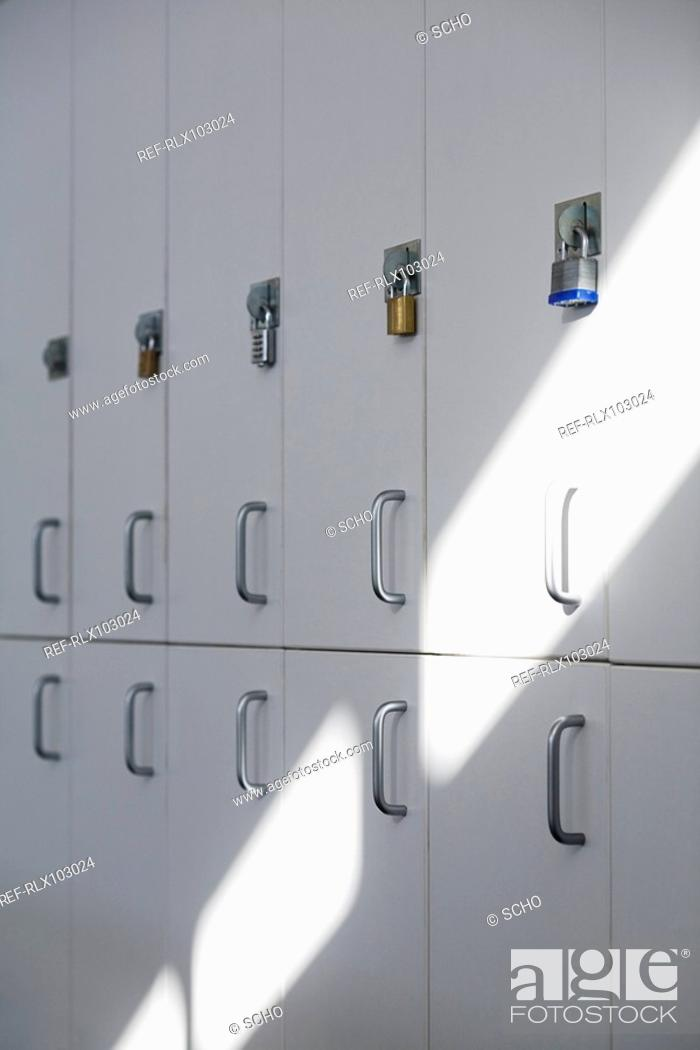 Stock Photo: Row of school lockers with Padlocks on doors.