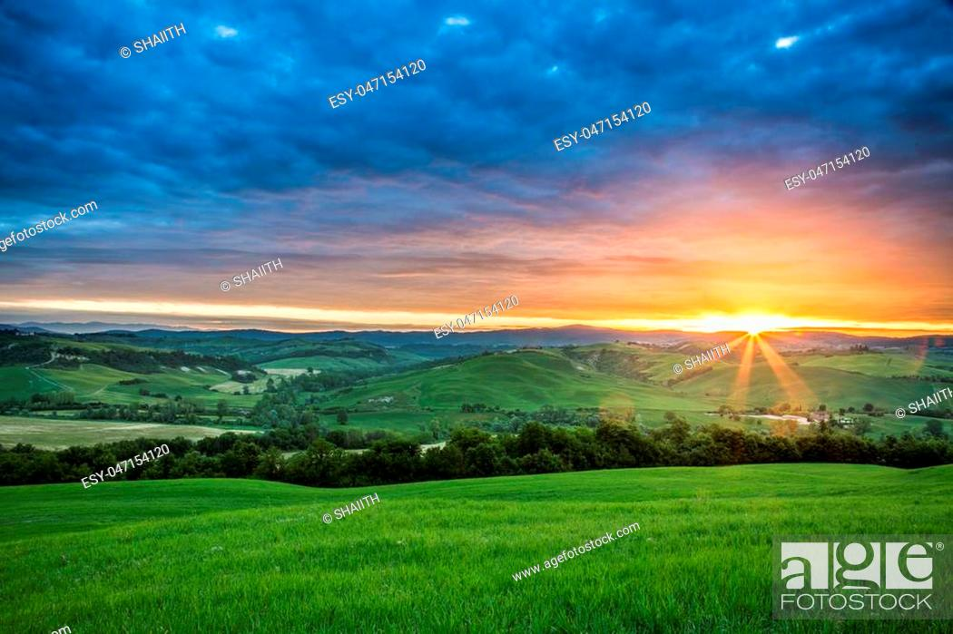 Stock Photo: Green fields in the valley at sunset, Tuscany, Italy.
