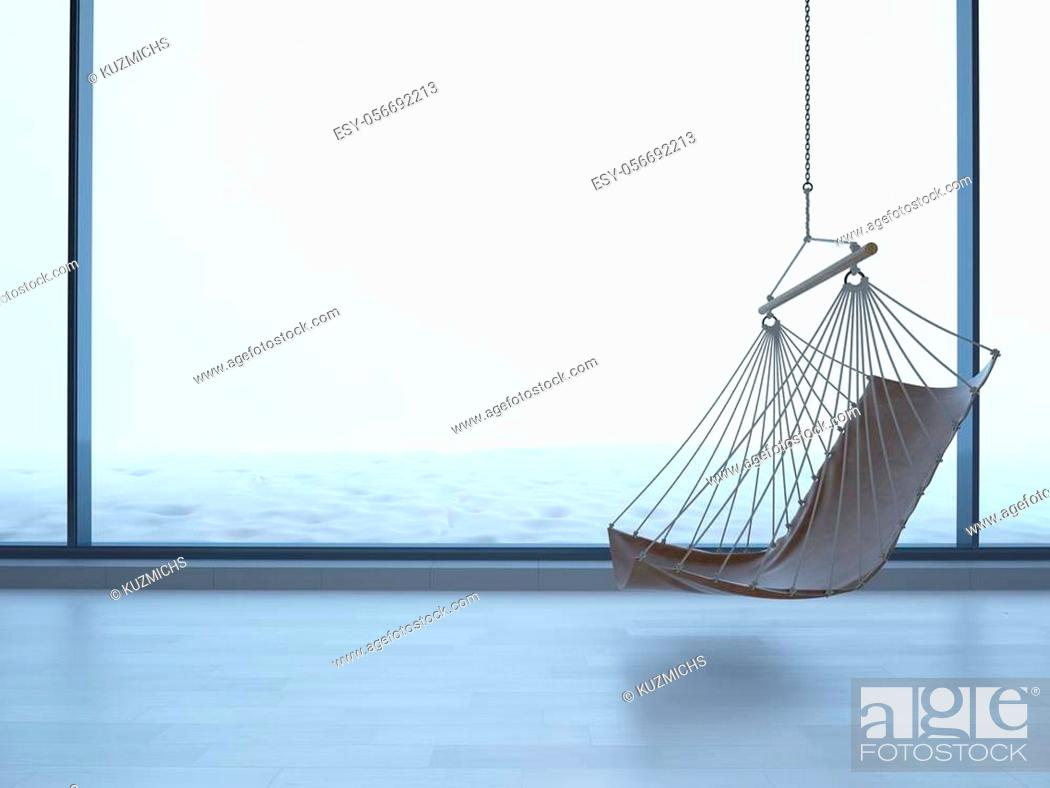 Stock Photo: hanging chair in an empty room on light parquet floor. Natural light from the window, reflection on the floor. Copy space. snow outside the window.