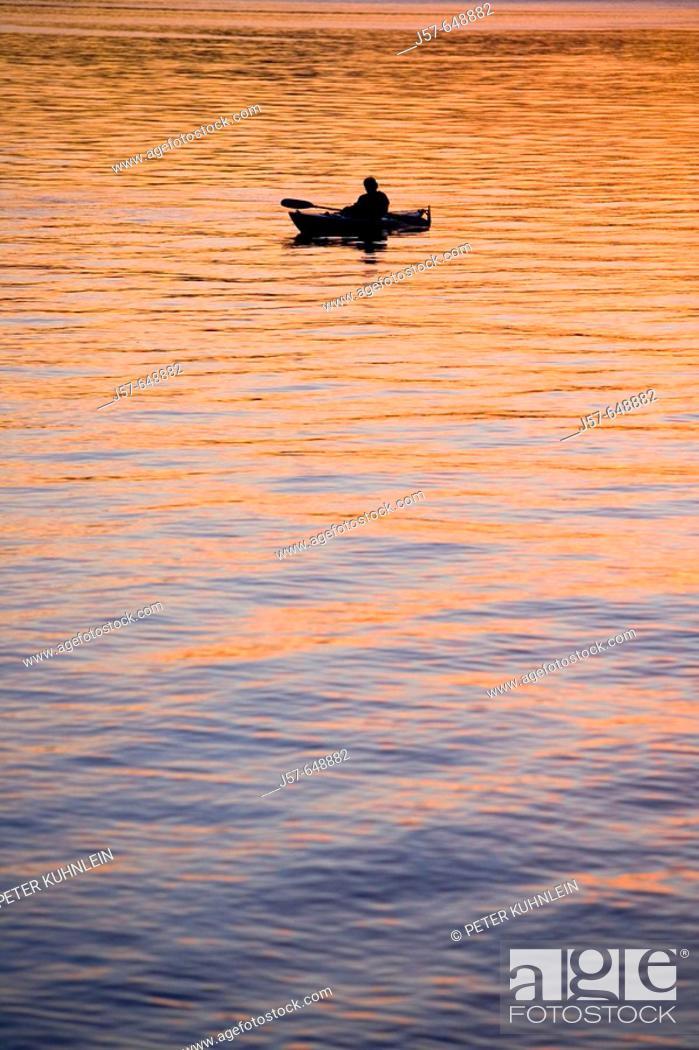 Stock Photo: Kayakers enjoying a sunset on the water in simlik bay. Washington.  NW USA.