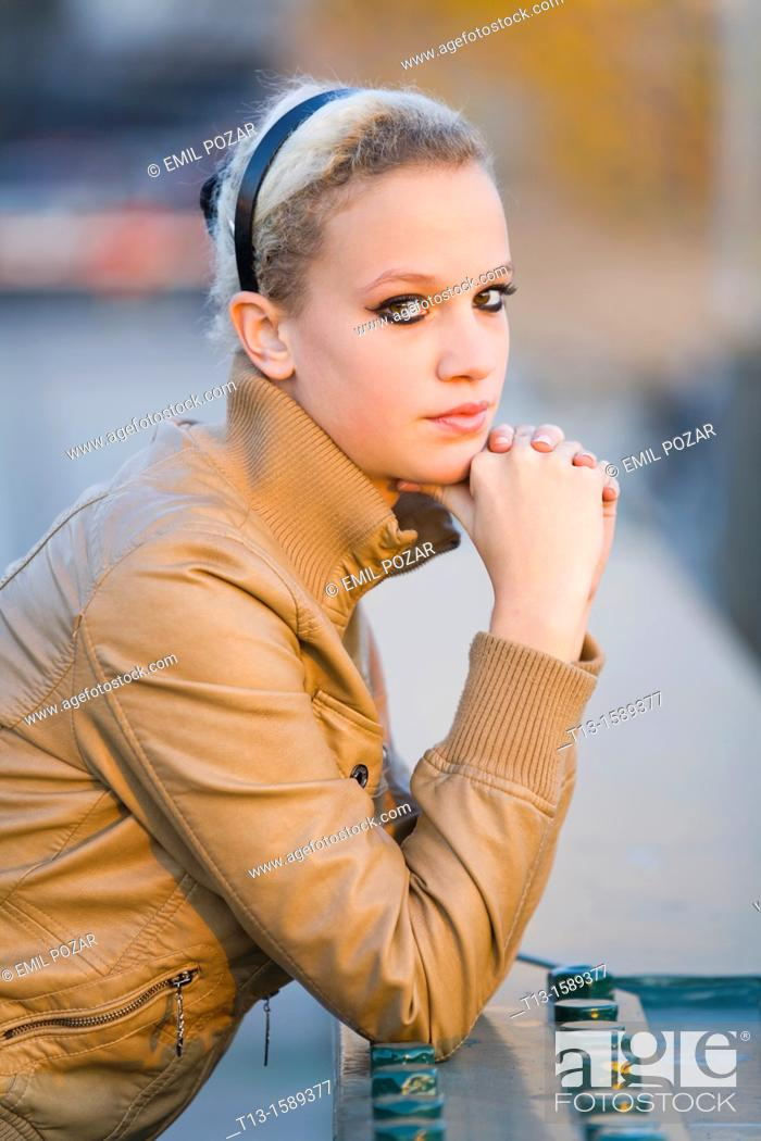 Stock Photo: Attractive young woman portrait, warm evening light.