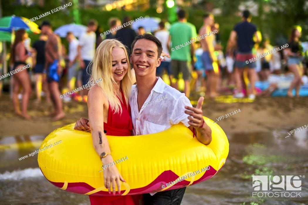 Stock Photo: Greece, Crete, Chersonissos, couple at Beach Party, inflatables.