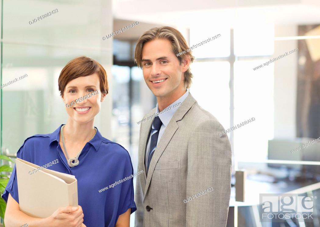 Stock Photo: Portrait of smiling business people in office.