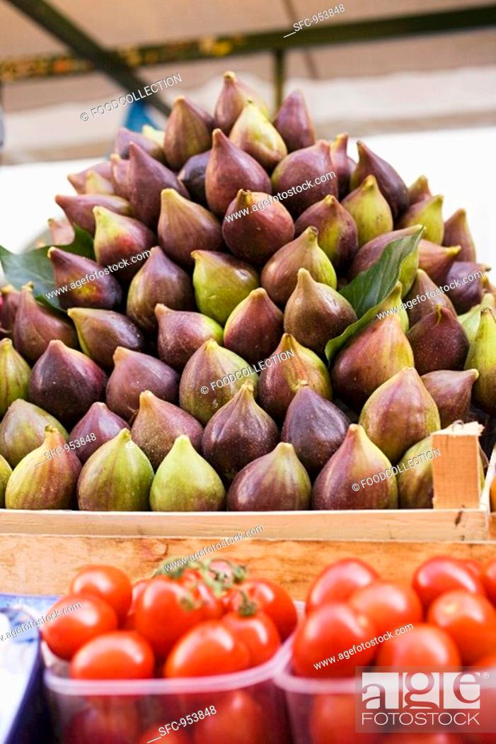 Stock Photo: Figs and tomatoes at a market.