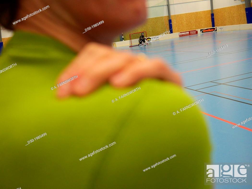 Stock Photo: Coach on floor ball field, Stockholm, Sweden.