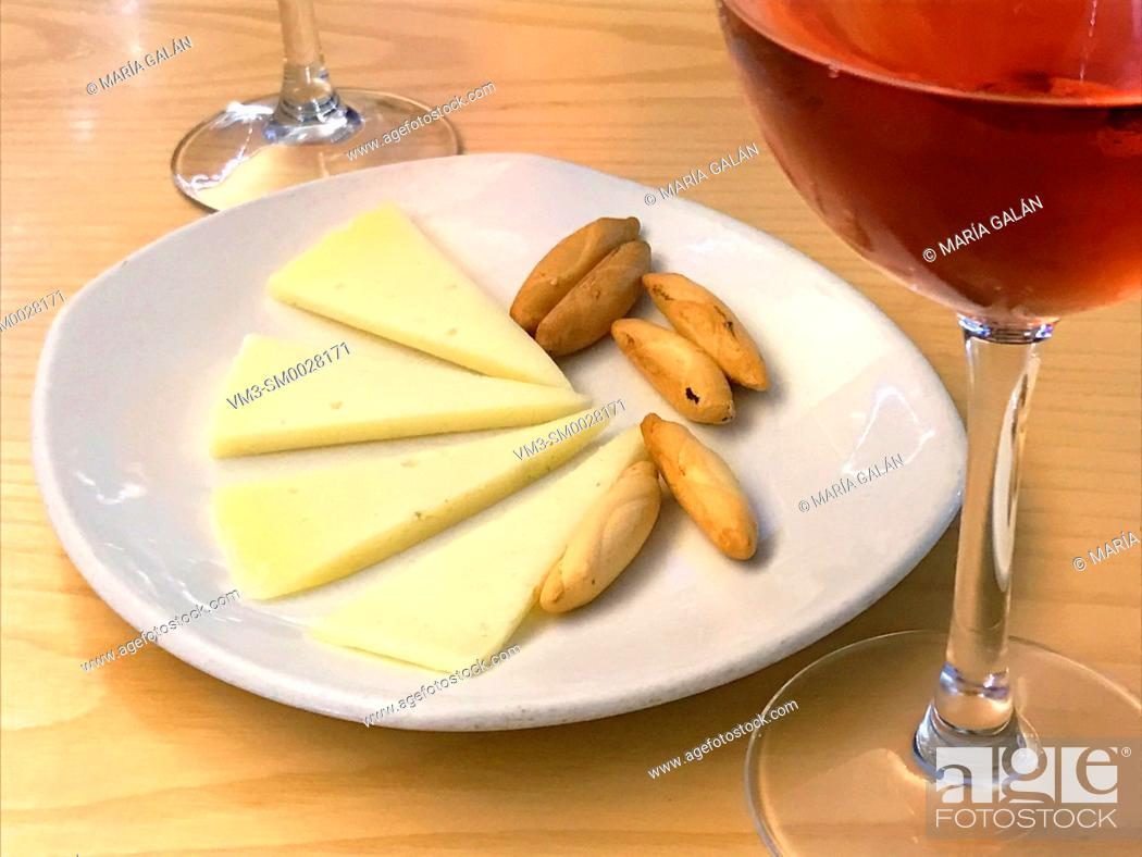 Stock Photo: Cheese and bread peaks with rose wine. Spain.