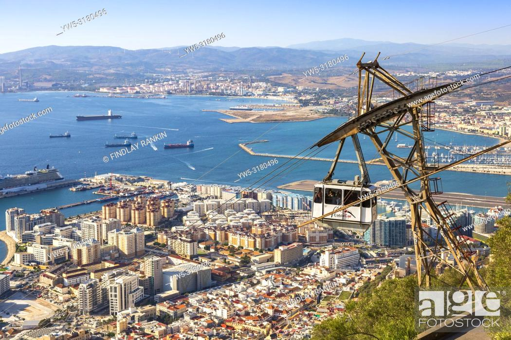Stock Photo: View over the Bay of Gibraltar from the Rock of Gibraltar showing the tourist styled cable car travelling from Gibraltar town to the top of the Rock.