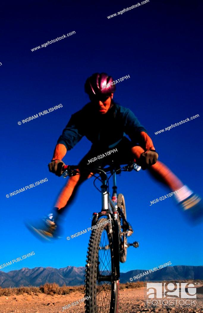 Stock Photo: young man doing tricks on a mountain bike.