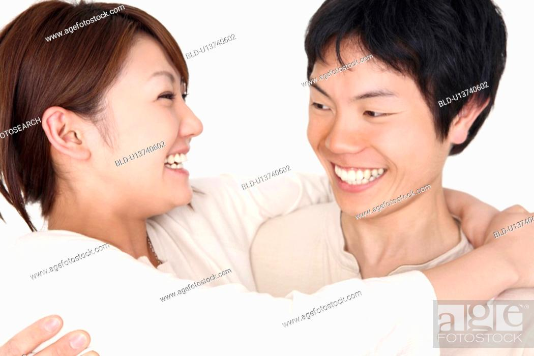 Stock Photo: Couple enbracing each other.