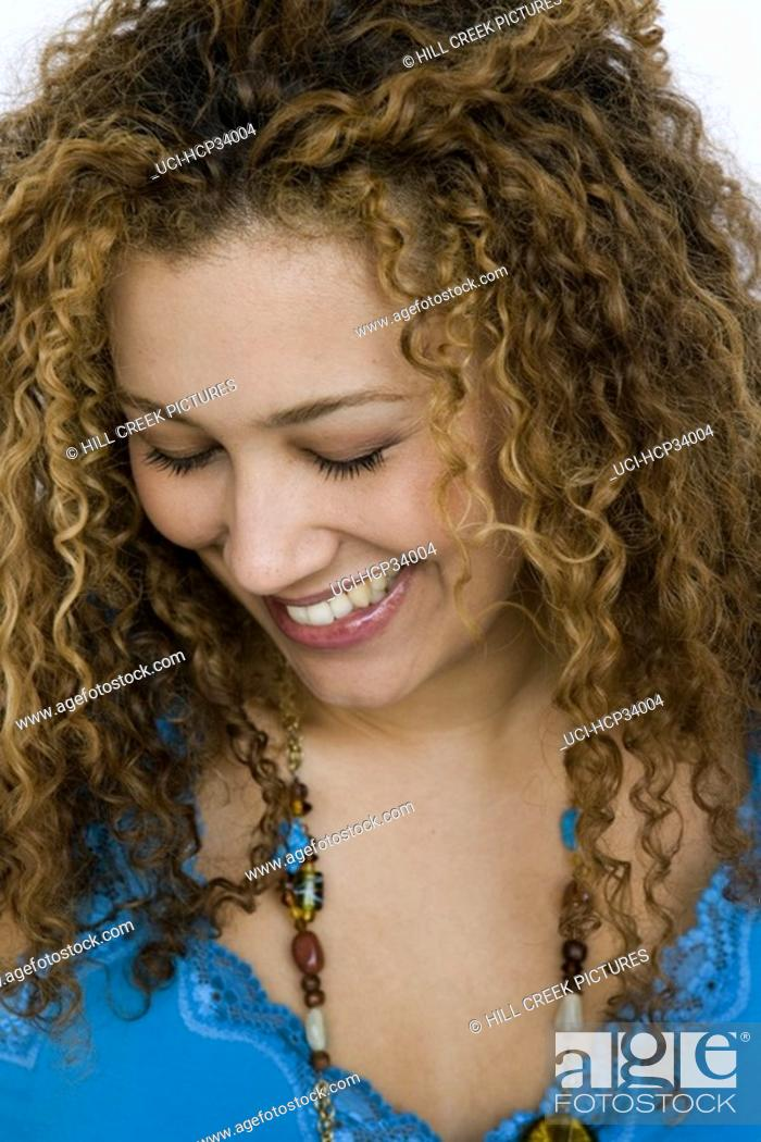 Stock Photo: Close-up of woman smiling with eyes closed.