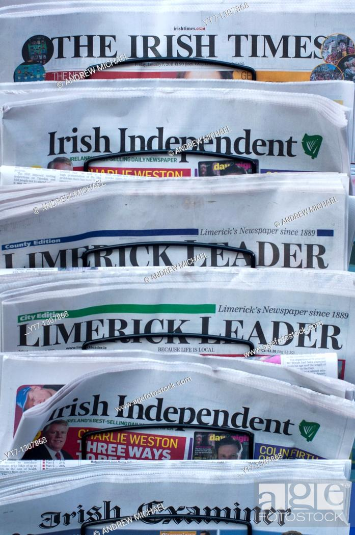 Stock Photo: Irish newspapers outside a newsagents shop in Limerick, Republic of Ireland.