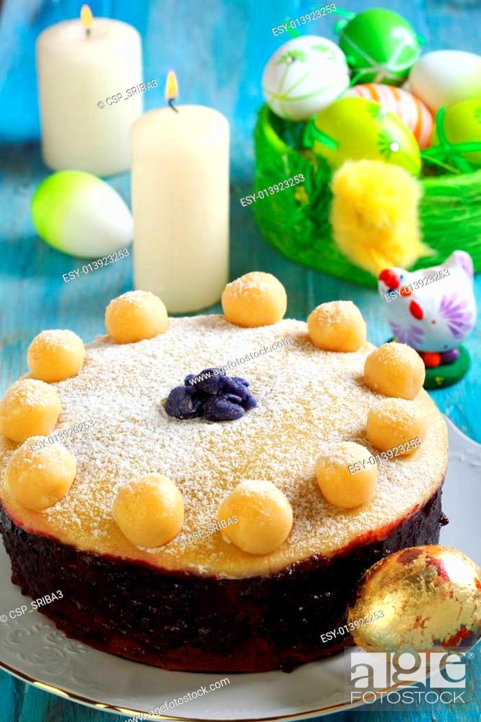Stock Photo: Easter cake and basket with colorful eggs.