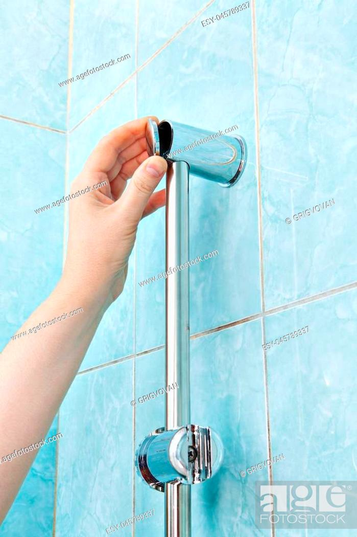 Stock Photo: Replace wall mounted vertical shower holder, remove the cover bracket slide rail bar.