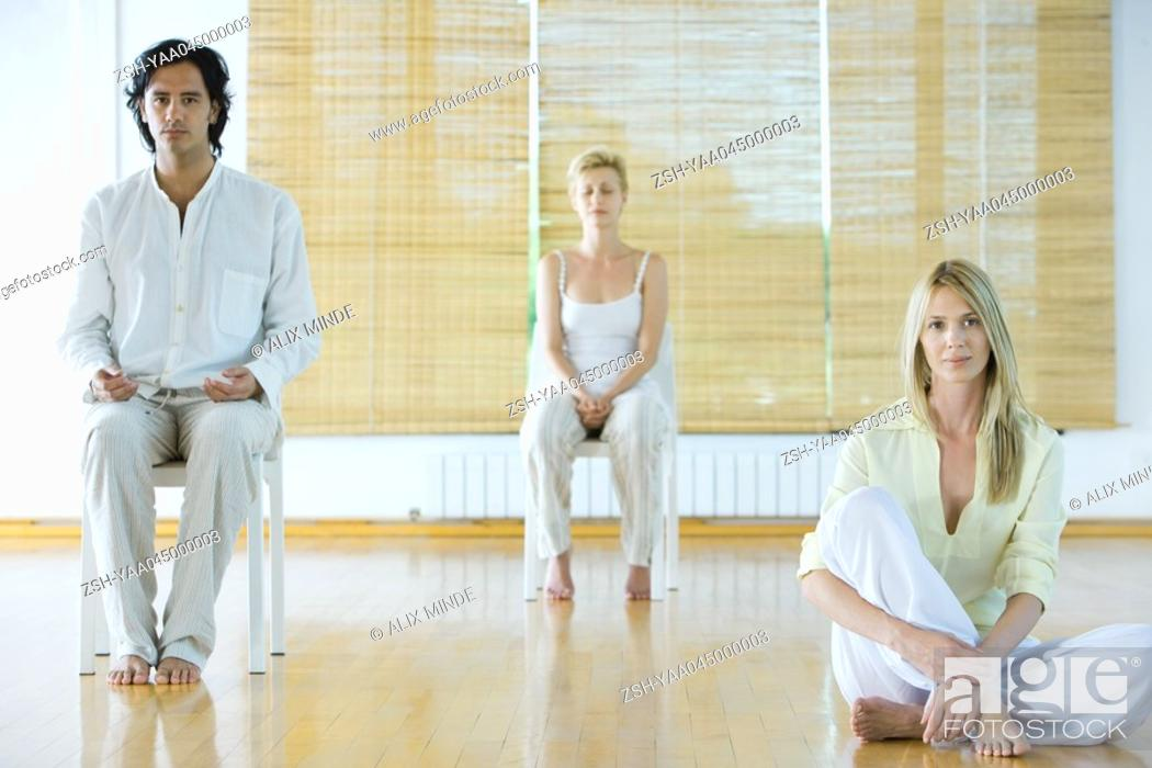 Stock Photo: Group meditation, adults sitting in different positions.